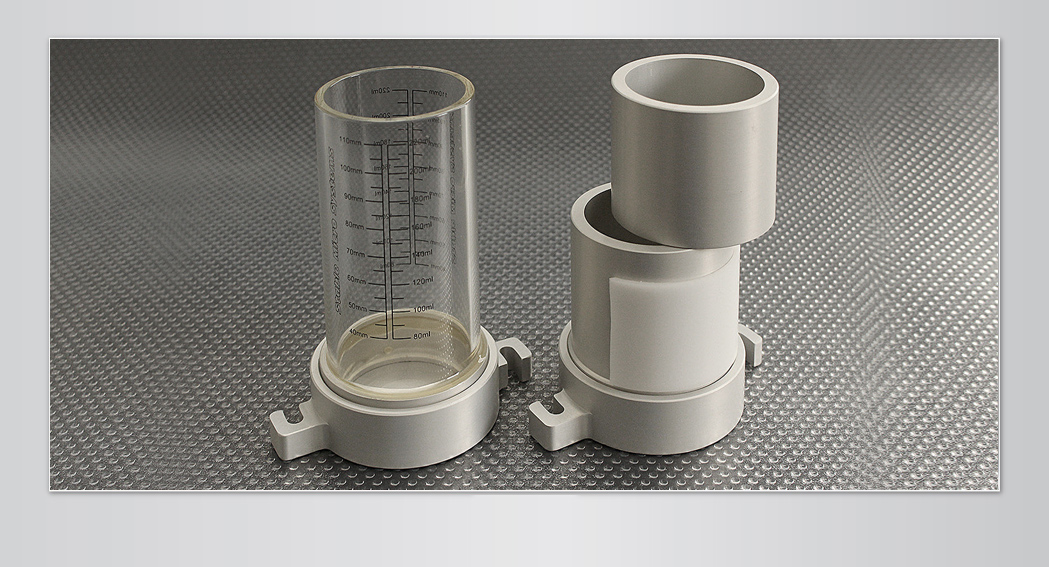 A glass vessel and split vessel are provided (for accurate measurement of bulk density)