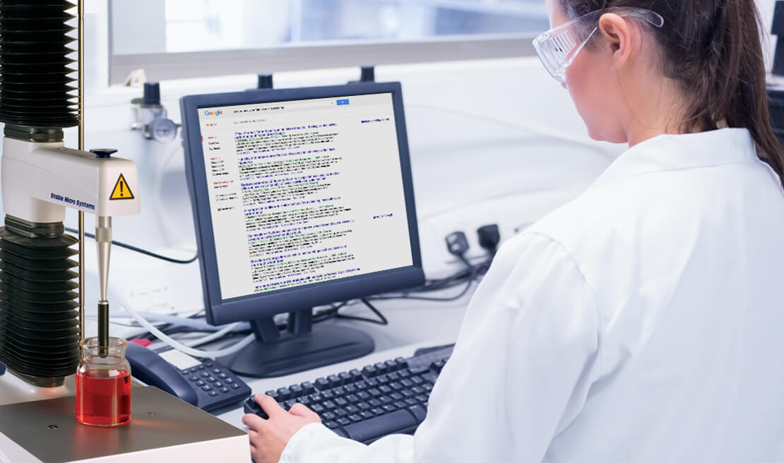 Technician referring to list of papers